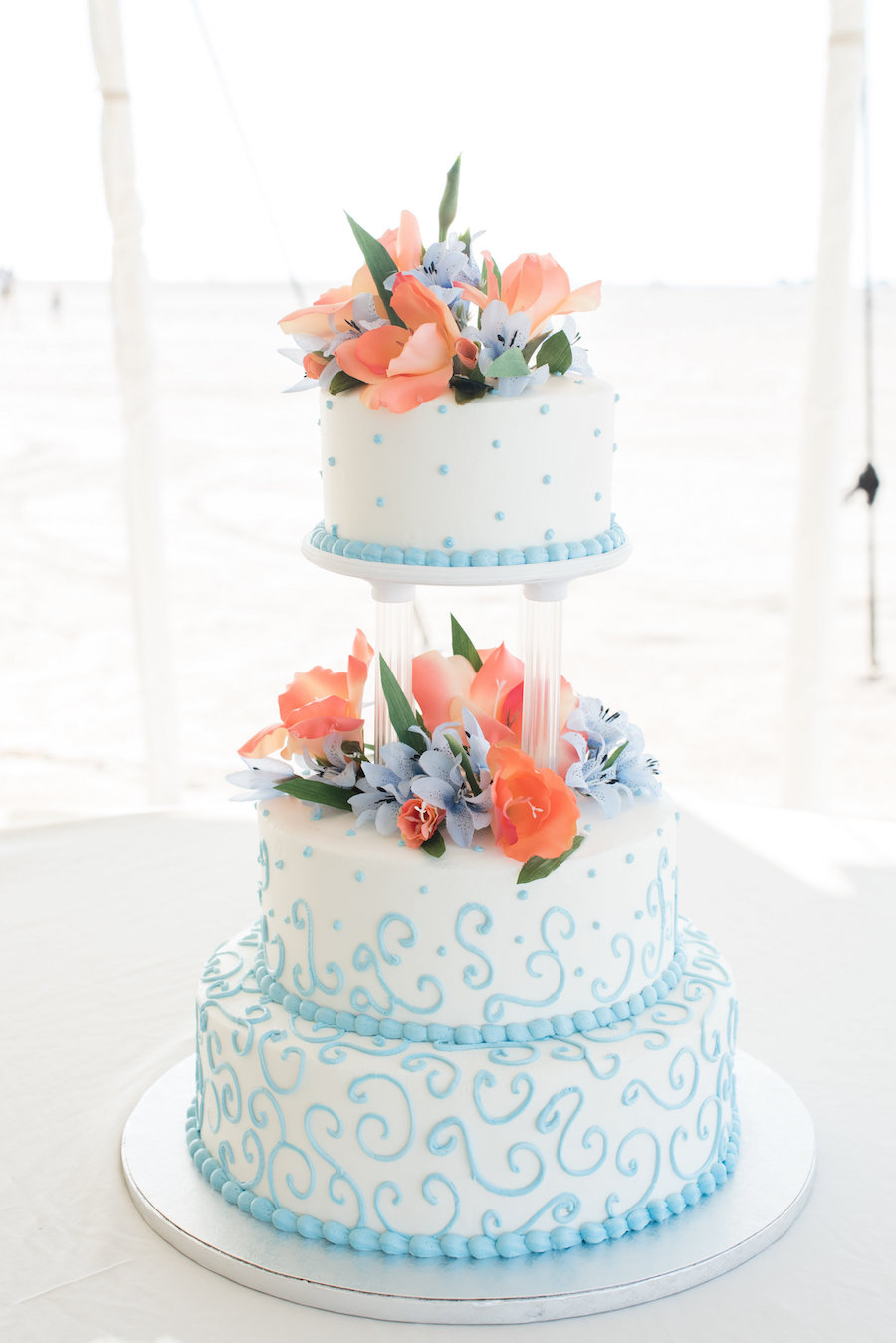 Light Blue and White Tiered Wedding cake with Coral and Light Blue Floral Accents  Clearwater Wedding Photographer Caroline and Evan Photography