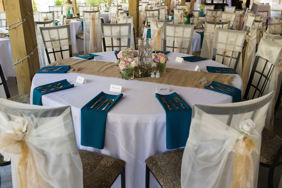Rustic Wedding Reception Table Decor With Burlap Table Runners, Teal  Napkins, And Purple And Pink Floral Centerpieces