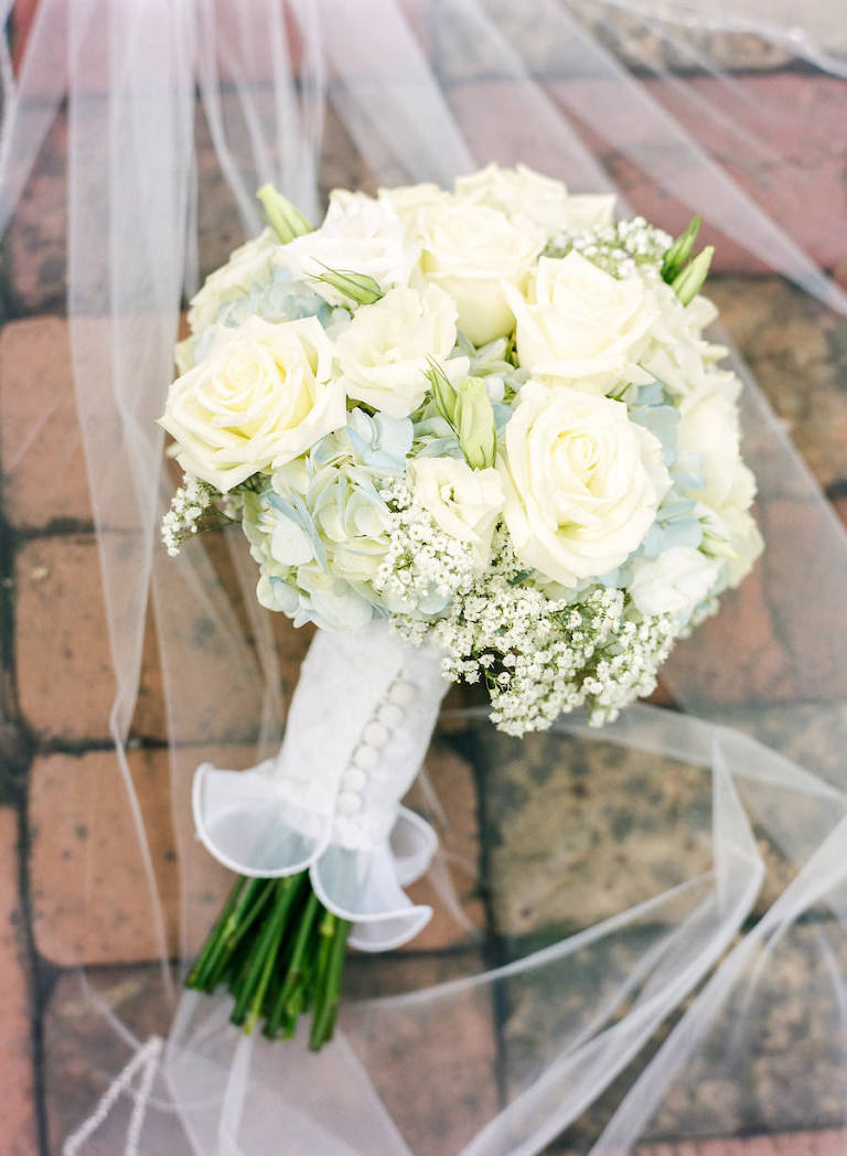 Bride's White Wedding Bouquet with Roses, Hydrangeas and Baby Breath with Veil and Button Detail