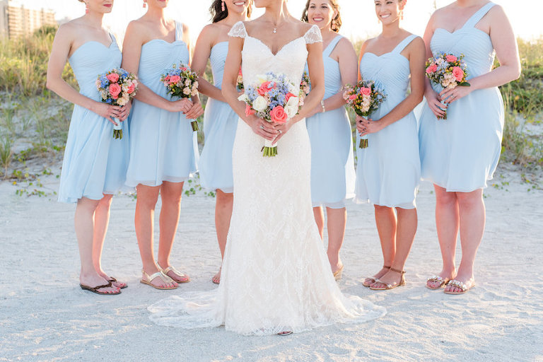 Florida Beach Bridal Wedding Day Portrait with Bridesmaids in Knee-Length Light Blue One Shoulder Dresses with Pink and Light Blue Wedding Bouquets | Clearwater Wedding Photographer Caroline & Evan Photography