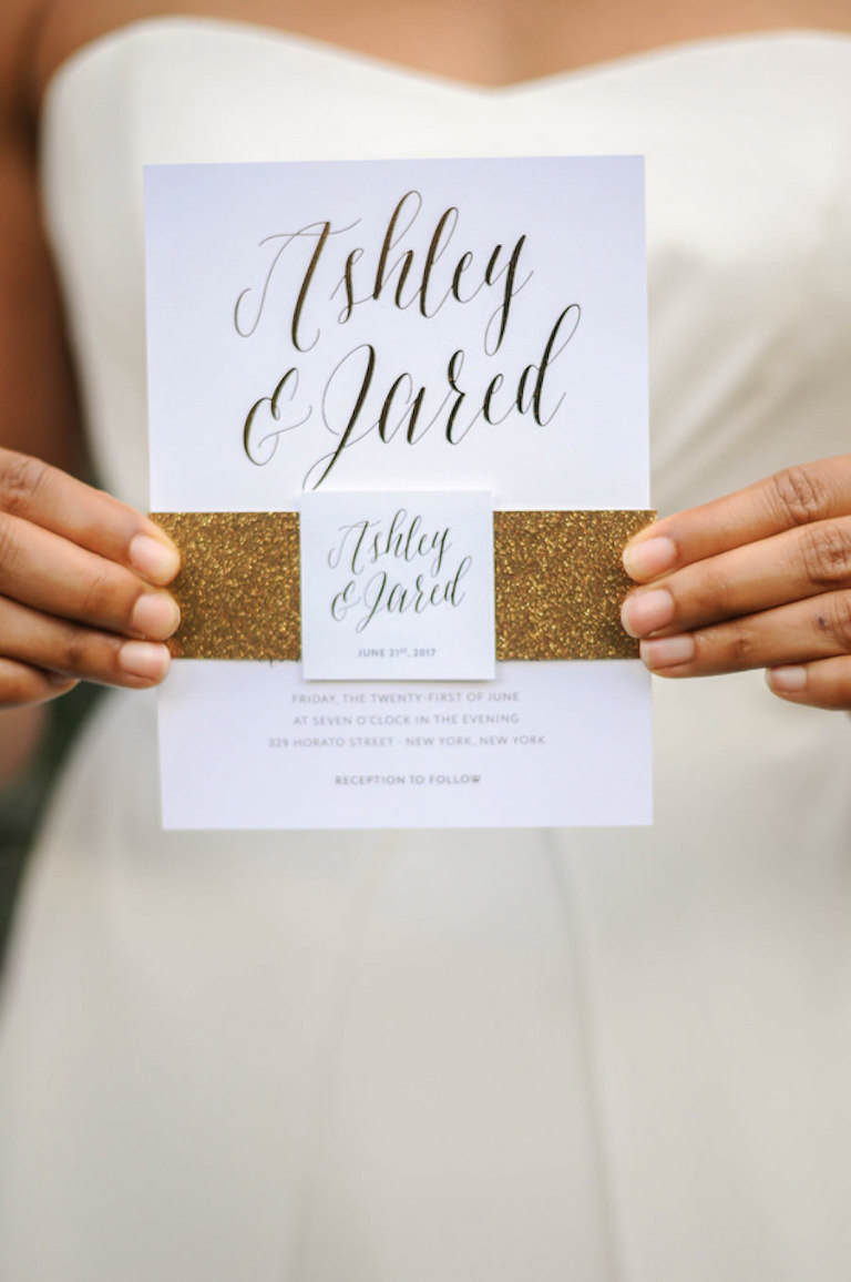 Wedding Day Portrait of Bride Holding Wedding Invitation | Wedding Invitation with Script Letters and Gold Glitter Band