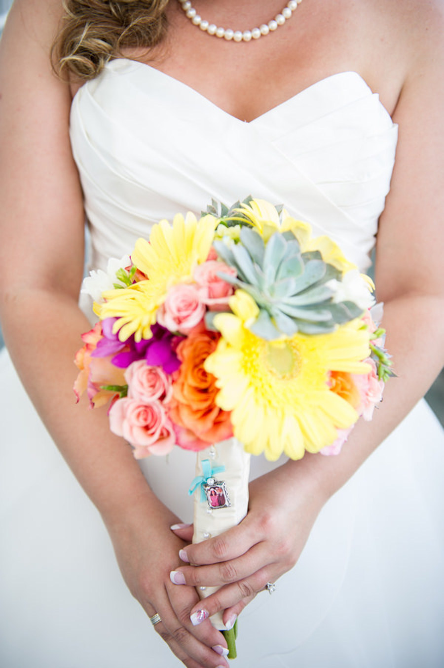Bridal Wedding Day Portrait in Strapless Wedding Gown with Pearl Necklace with Vibrant Bouquet with Yellow, Orange and Pink Flowers with Succulent and Memorial Locket   St. Pete Wedding Photographer Andi Diamond Photography