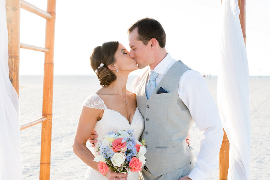 Bridal Wedding Day First Kiss During Beach Wedding Ceremony  Clearwater Wedding Photographer Caroline and Evan Photography