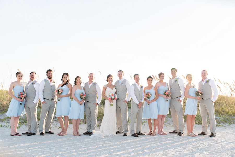 Wedding Day Bridal Party Portrait on Beach with Bridesmaids in Light Blue Knee Length Dresses and Groomsmen in Light Grey Suits   Clearwater Wedding Photographer Caroline and Evan Photography