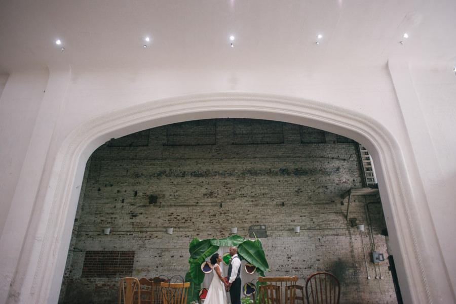 Eco-Friendly, Tropical, Carribean Wedding Arch of Palm Leaves | Rialto Theatre Modern Tampa Wedding Venue