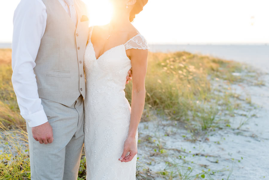 Florida Sunset Beach Wedding Portrait of Bride in Wedding Dress and Groom in Light Grey Suit with Vest   Clearwater Wedding Photographer Caroline and Evan Photography