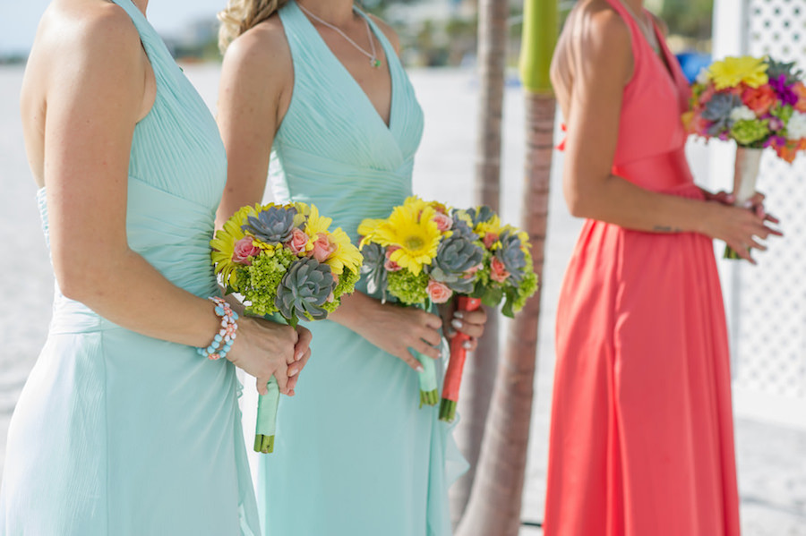 Florida Beach Wedding Ceremony Portrait with Bridesmaids in Mint and Coral Dresses with Wedding Bouquet with Yellow Flowers and Succulents   St. Pete Wedding Photographer Andi Diamond Photography