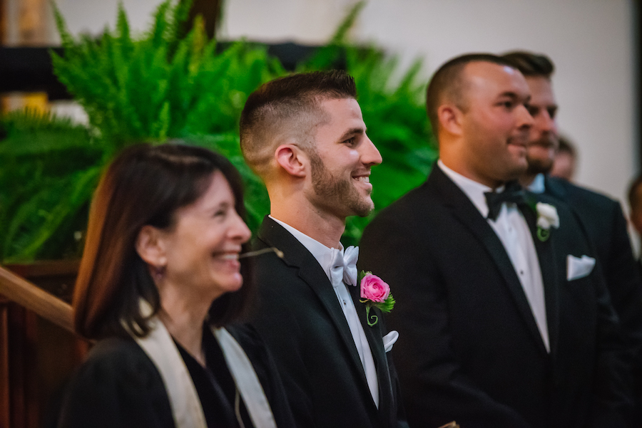 Groom at the Altar Wedding Ceremony Portrait | Black Tuxedo with Pink and Green Boutonniere