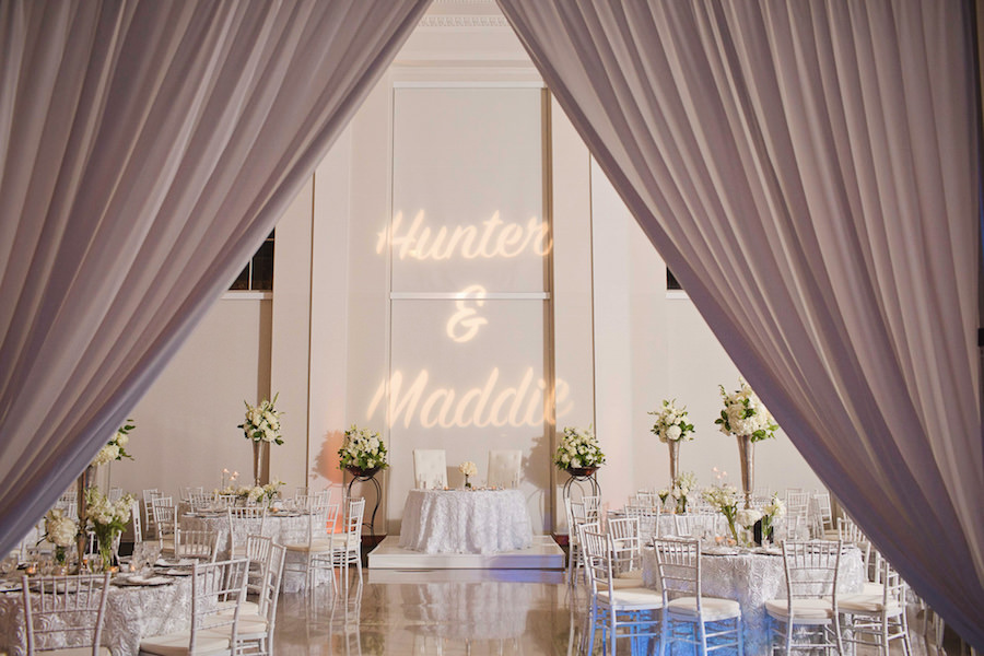 Tampa Wedding Reception White and Gold Decor with Bride and Groom Name GOBO Projection   Downtown Tampa Wedding Venue The Vault