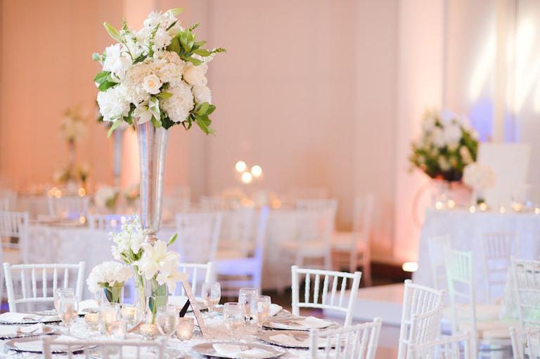 Wedding Reception Decor with Tall, Ivory and Blush Pink Floral Centerpieces and White Chiavari Chairs | Tampa Wedding Venue The Vault