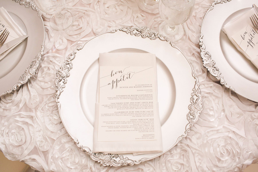 Wedding Reception Table Decor with White Rosette Linens, Silver Chargers, and Bon Appetit Menu   Tampa Event Rentals Signature Event Rentals