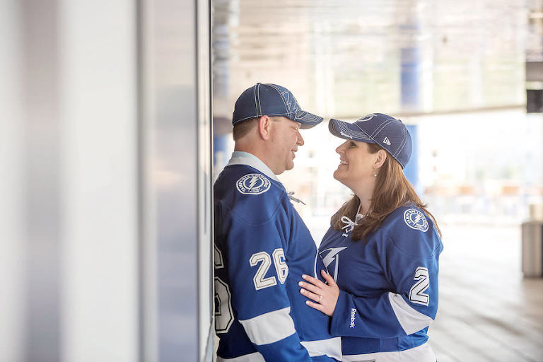 Tampa Lightning Themed Engagement Session at Amalie Arena with Hockey Jerseys | Kristen Marie Photography