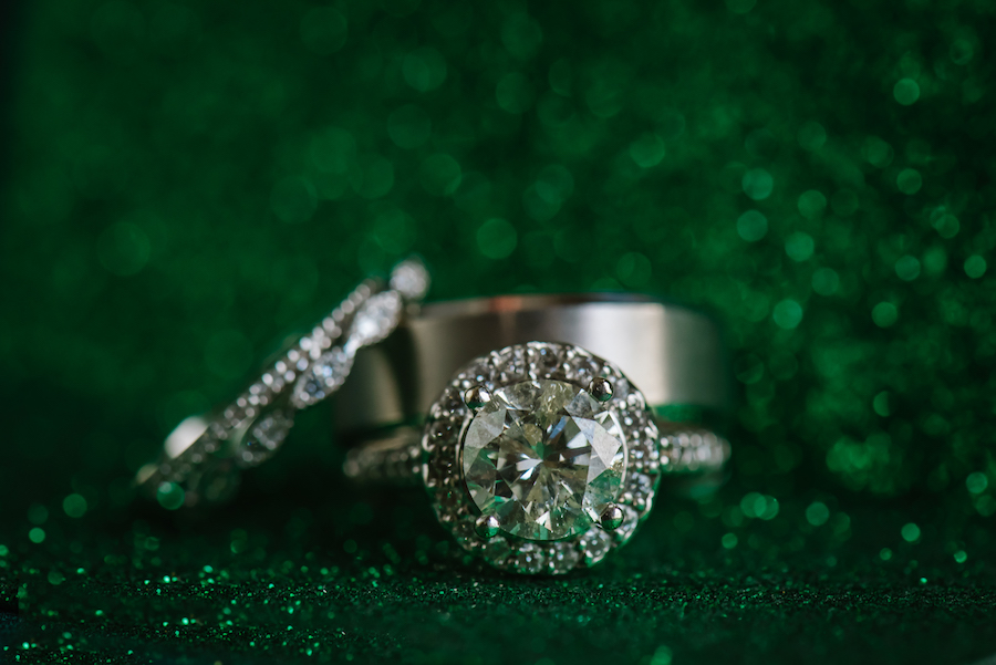 Round Cut Diamond Engagement Ring With Halo and Wedding Bands Portrait on Emerald Green Sparkles