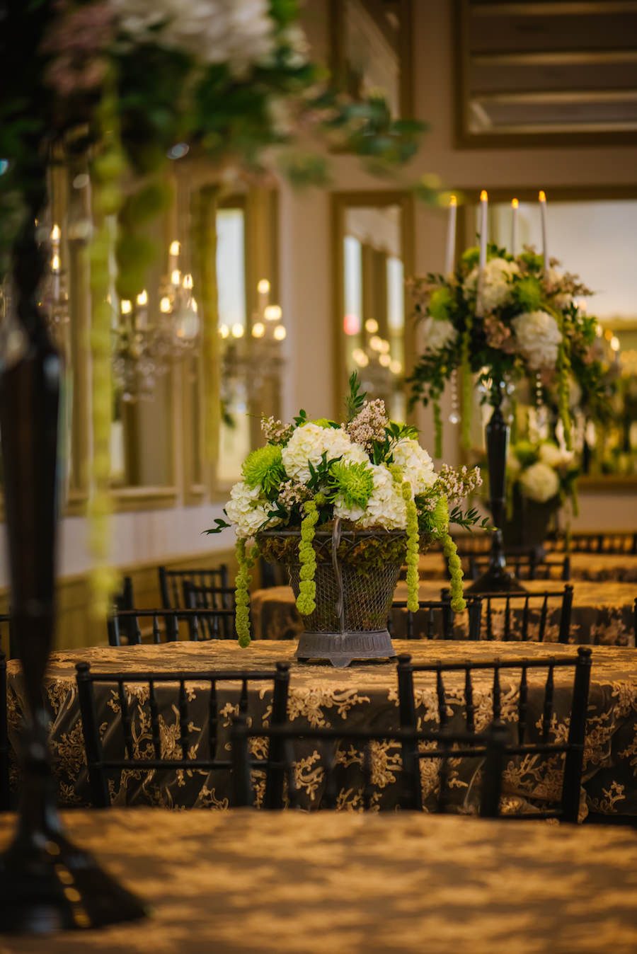 Cascading White and Green Hydrangea and Spider Flower Wedding Centerpiece in Dark Bronze Vase on Embroidered Gold Tablecloths | Tampa Wedding Florist Apple Blossoms Floral Designs