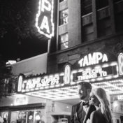 Outdoor, Nighttime, Downtown Tampa Bride and Groom Wedding Portrait at Tampa Theatre Marquee | Tampa Wedding Photographer Marc Edward Photographs