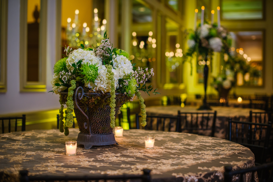 Elegant Wedding Reception with Green, Gold and Ivory Centerpieces in Bronze Rod Iron Vase on Gold Tablecloth | Tampa Wedding Florist Apple Blossoms Floral Designs