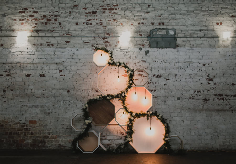 Wedding Reception Wall Decor with Wooden Geometric Shaped and Lights   Downtown Tampa Wedding Venue The Rialto
