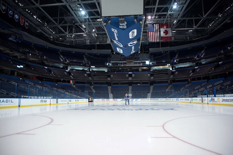 Tampa Lightning Themed Engagement Session at Amalie Arena with Hockey Jerseys on Ice | Kristen Marie Photography