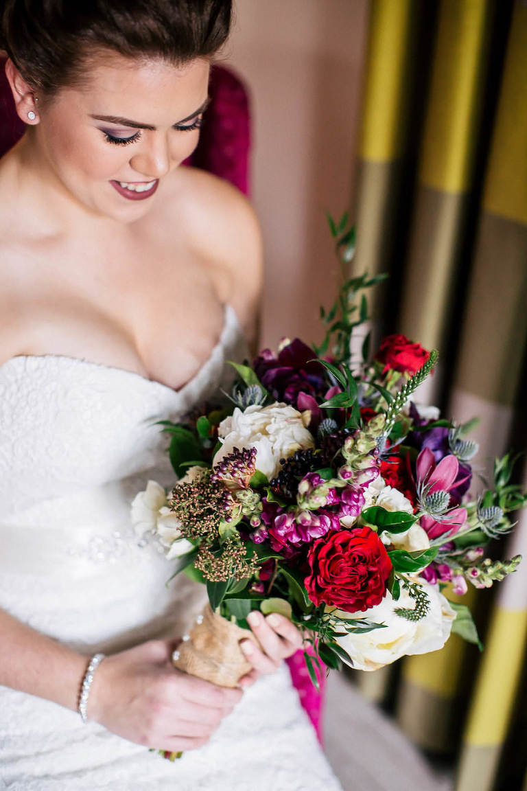 Bride with Red and Pink Wedding Bouquet with Greenery