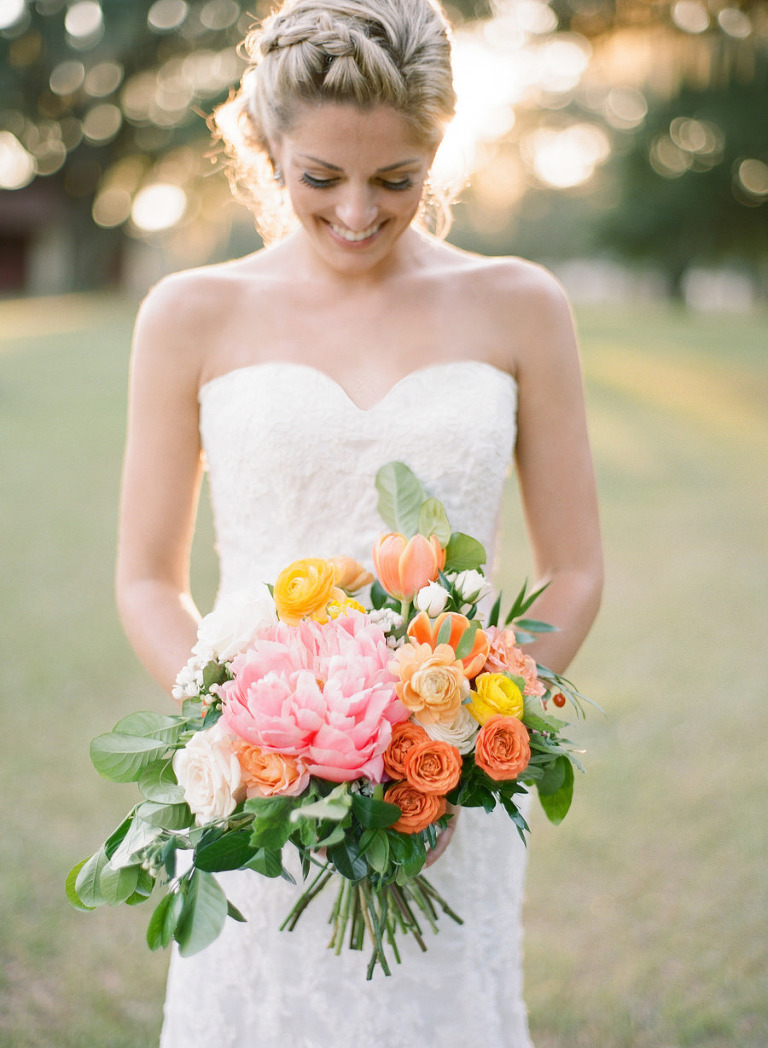 Tampa Bay Florida Bride in Sweetheart Wedding Dress with Orange, Yellow and Pink Wedding Bouquet