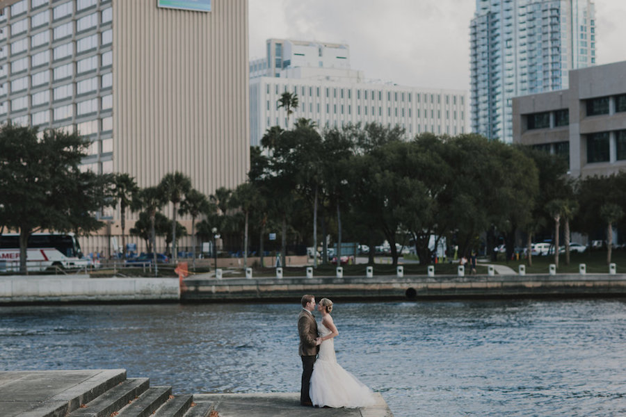 Outdoor, Downtown Tampa Waterfront Bride and Groom Wedding Portrait in Tan Suit and Ivory, Strapless JLM Couture Wedding Dress