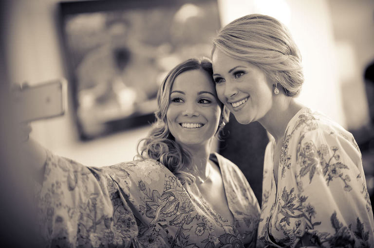 Bride and Bridesmaid Taking Selfie Getting Ready Portrait in Paisley Floral Robes