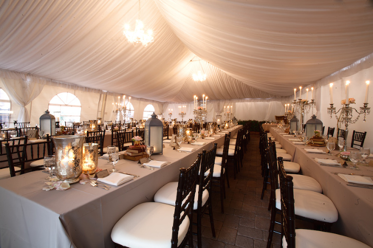 Outdoor Tented Wedding Reception with Long Feasting Tables with Elegant Decor and Lantern Centerpieces with Black Chiavari Chairs| Tampa Wedding Planning by UNIQUE Weddings and Events