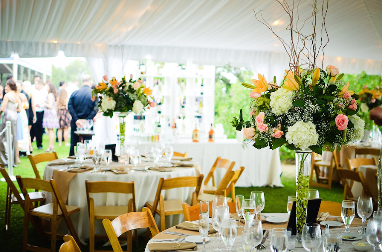 Outdoor Tented Garden Wedding Reception with Wooden Folding Chairs and Tall Centerpieces| Tampa Wedding Planning by UNIQUE Weddings and Events