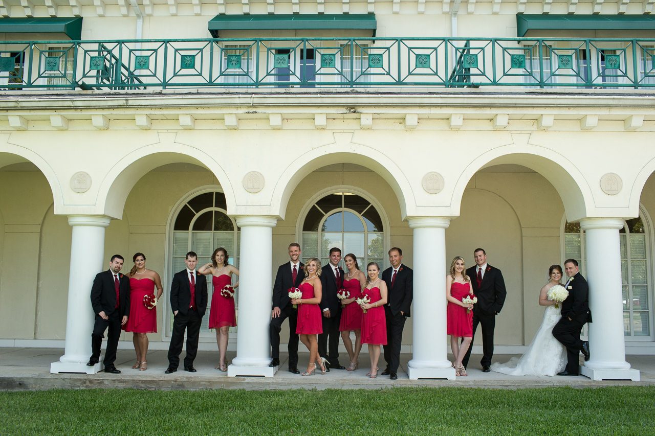 Outdoor, Bridal Party Wedding Portrait in Red Bridesmaids Dresses and Black and Red Groomsmen Suits | Tampa Wedding Venue Tampa Palms Golf and Country Club | Tampa Wedding Photographer Jeff Mason Photography