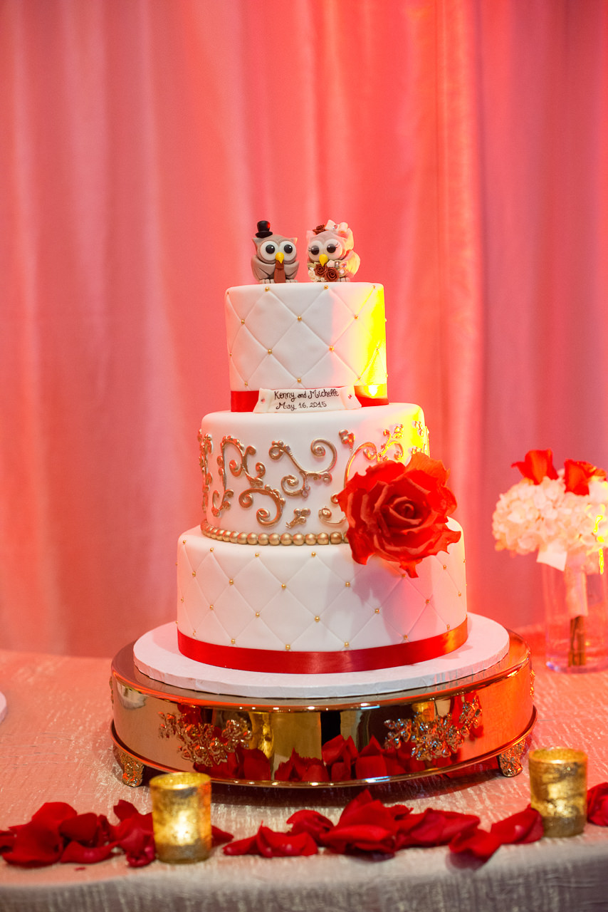 Three Tiered, Round White and Red Tampa Wedding Cake with Red Flower Accents and Owl Cake Topper