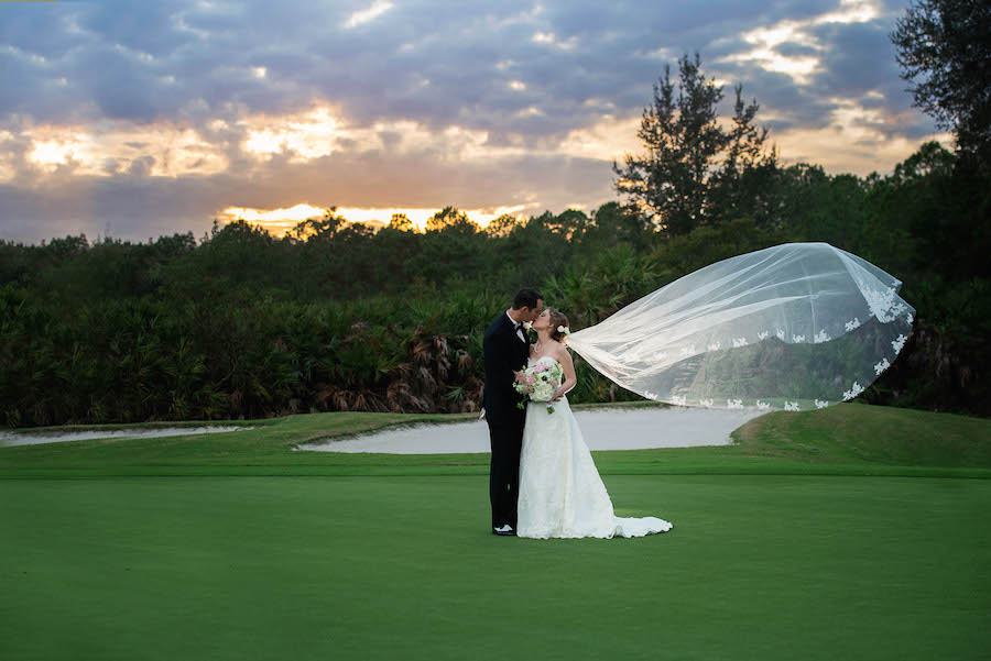 Tampa Bride and Groom Wedding Portrait in Ivory Alfred Angelo Lace Wedding Dress with Ivory and Pink Floral Wedding Bouquet | Tampa Wedding Floral Designer Northside Florist | Tampa Golf Course Wedding Venue Hunter's Green Country Club