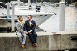 St. Petersburg Waterfront Marina Same Sex Wedding Portrait in Navy Blue and Gray Suits | Nautical Inspired Florida Wedding