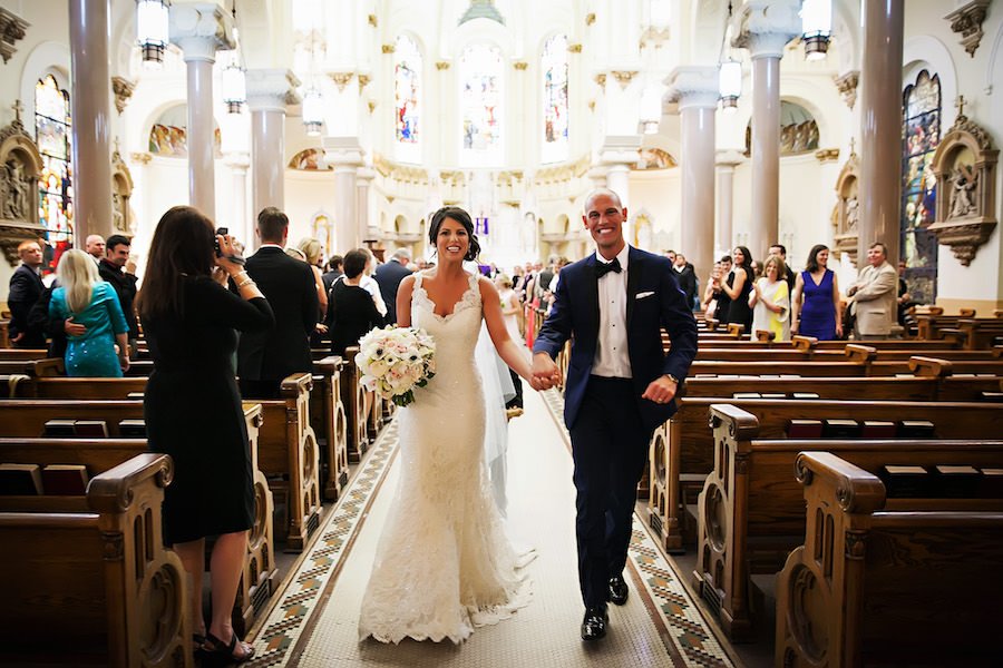 Bride and Groom Walking Down Aisle at Tampa Catholic Wedding Ceremony at Sacred Heart Church | Tampa Wedding Photographer Limelight Photography