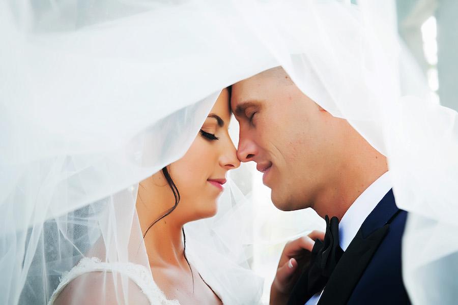 Tampa Bride and Groom Wedding Portrait under Bridal Veil | Tampa Wedding Photographer Limelight Photography