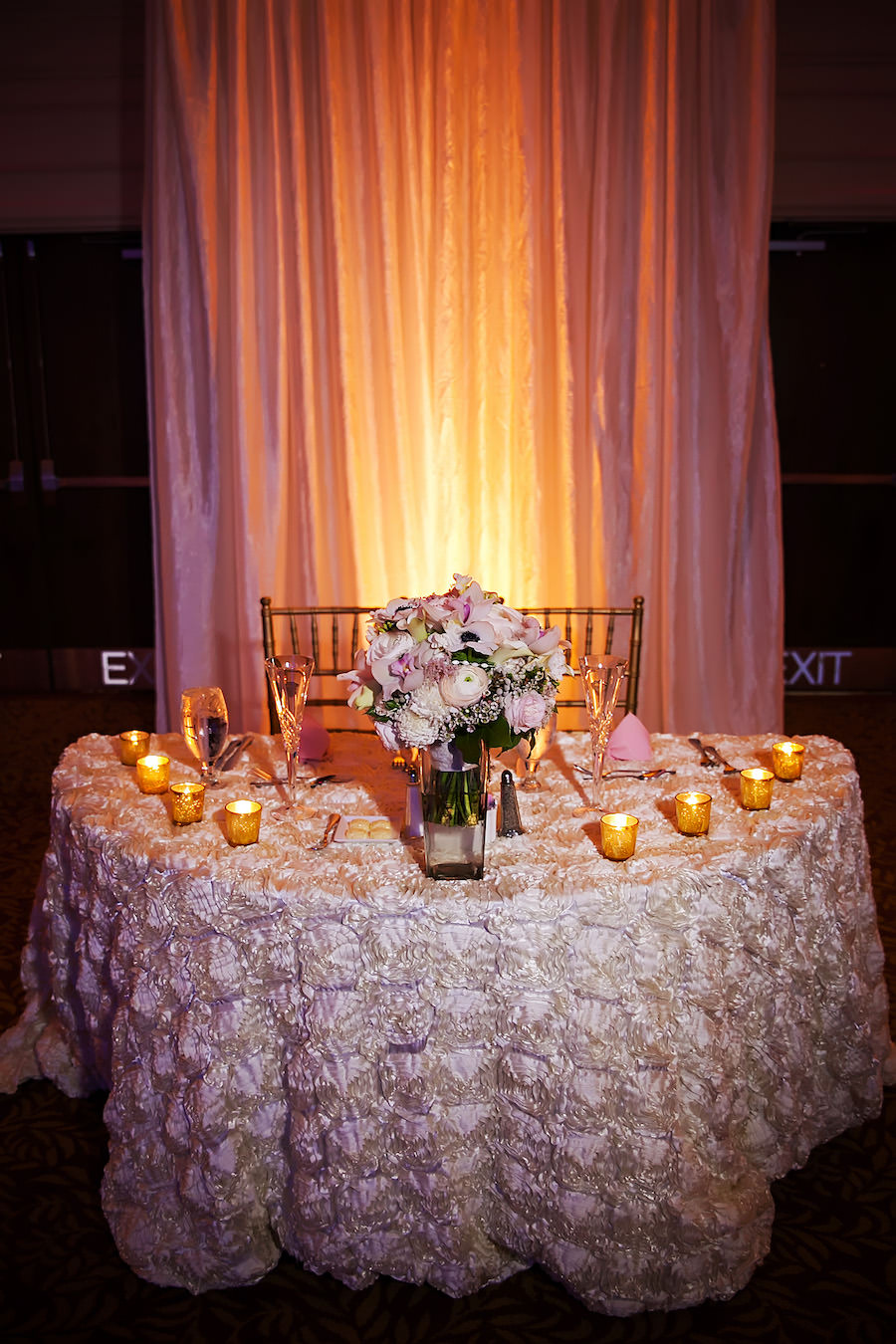 Tampa Wedding Reception Sweetheart Table Decor with Pastel, Blush Rosette Linen, Candles, and Ivory Bridal Bouquet | | Tampa Wedding Linen Rentals Over the Top Linens