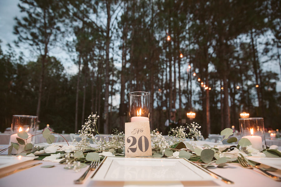 Rustic Wedding Table Dressing with Baby's Breath, White Candles and Greenery on Light Pink Tablecloths with Gold Accent   Tampa Bay Wedding Floral Designer Northside Florist