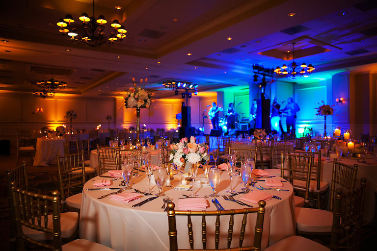 Tampa Hotel Wedding Reception Decor with Gold Chiavari Chairs, Pink, Red, and White Floral Centerpieces and Wedding Reception Decor with Projection Floor GOBO Monogram, and Blue Uplighting | Tampa Wedding Lighting Gabro Event Services