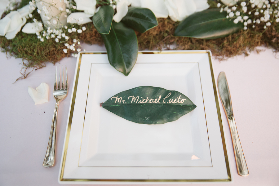 Rustic Wedding Table Setting and Name Card with Ivory Rose Petals, Baby's Breath and Greenery | Tampa Bay Wedding Planner Glitz Events