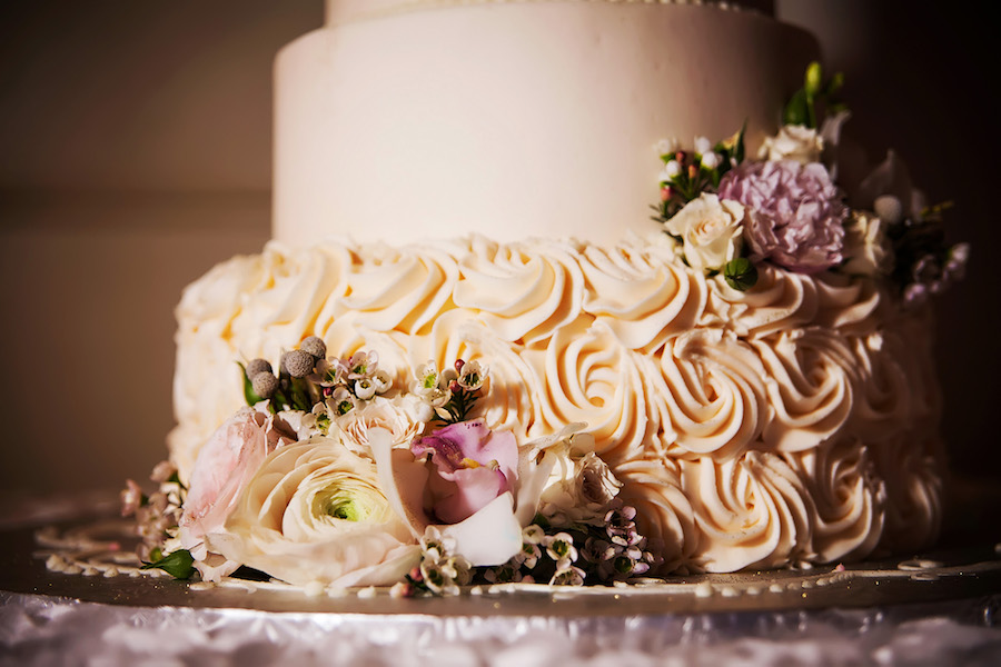 Ivory Rosette Icing and Floral Accents on Elegant Round Wedding Cake