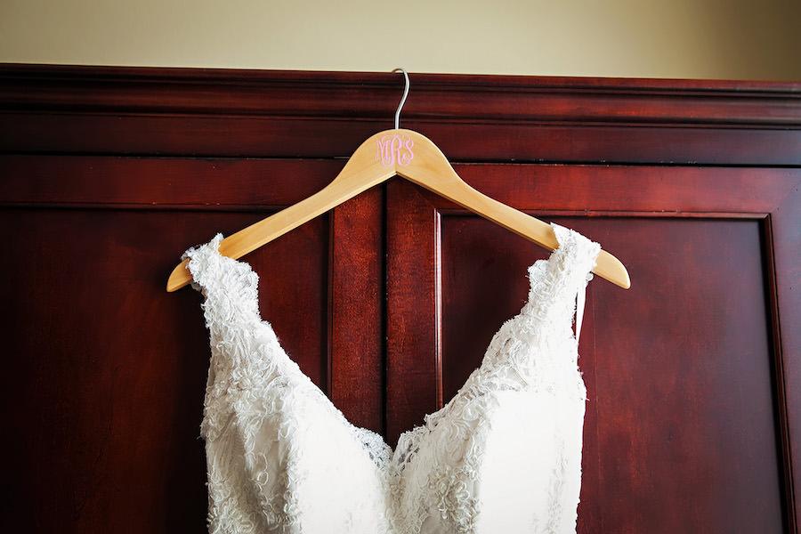White, Ivory Romona Keveza Lace Wedding Gown with Straps on Monogram Wedding Hanger | Tampa Wedding Dress Shop Isabel O'Neil Bridal