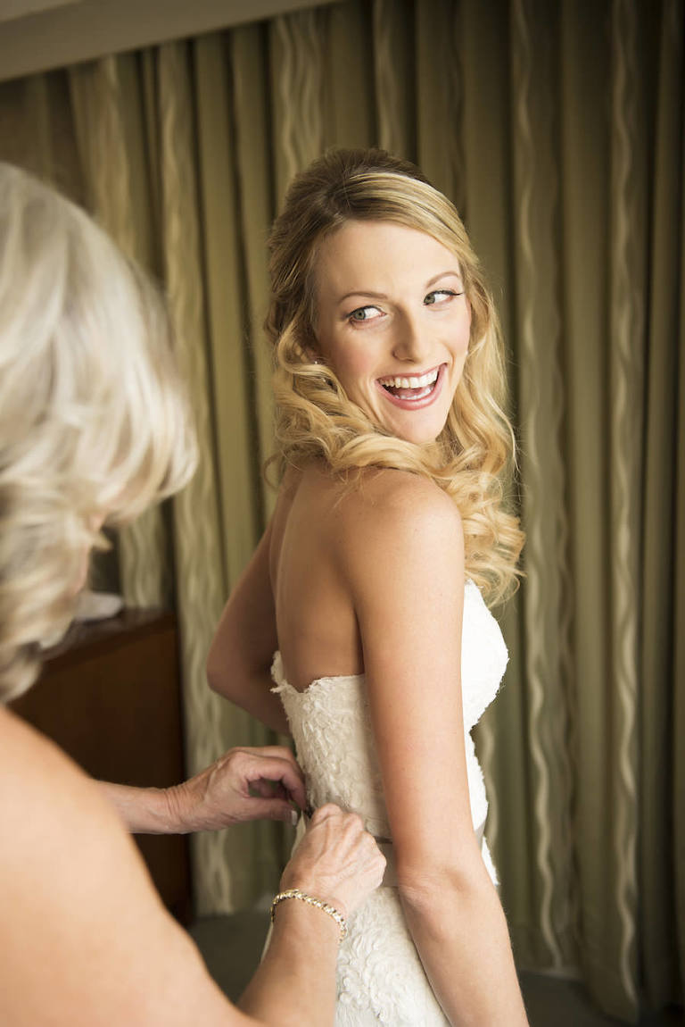 Bride Getting Dressed/Ready in White, Lace, Strapless Wedding Dress