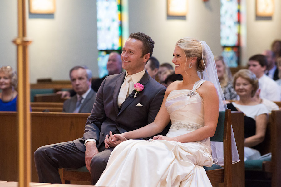 Bride in Allure Wedding Dress and Groom at Altar at Catholic Church Wedding Ceremony | St. Pete Wedding Photographer Jeff Mason Photography