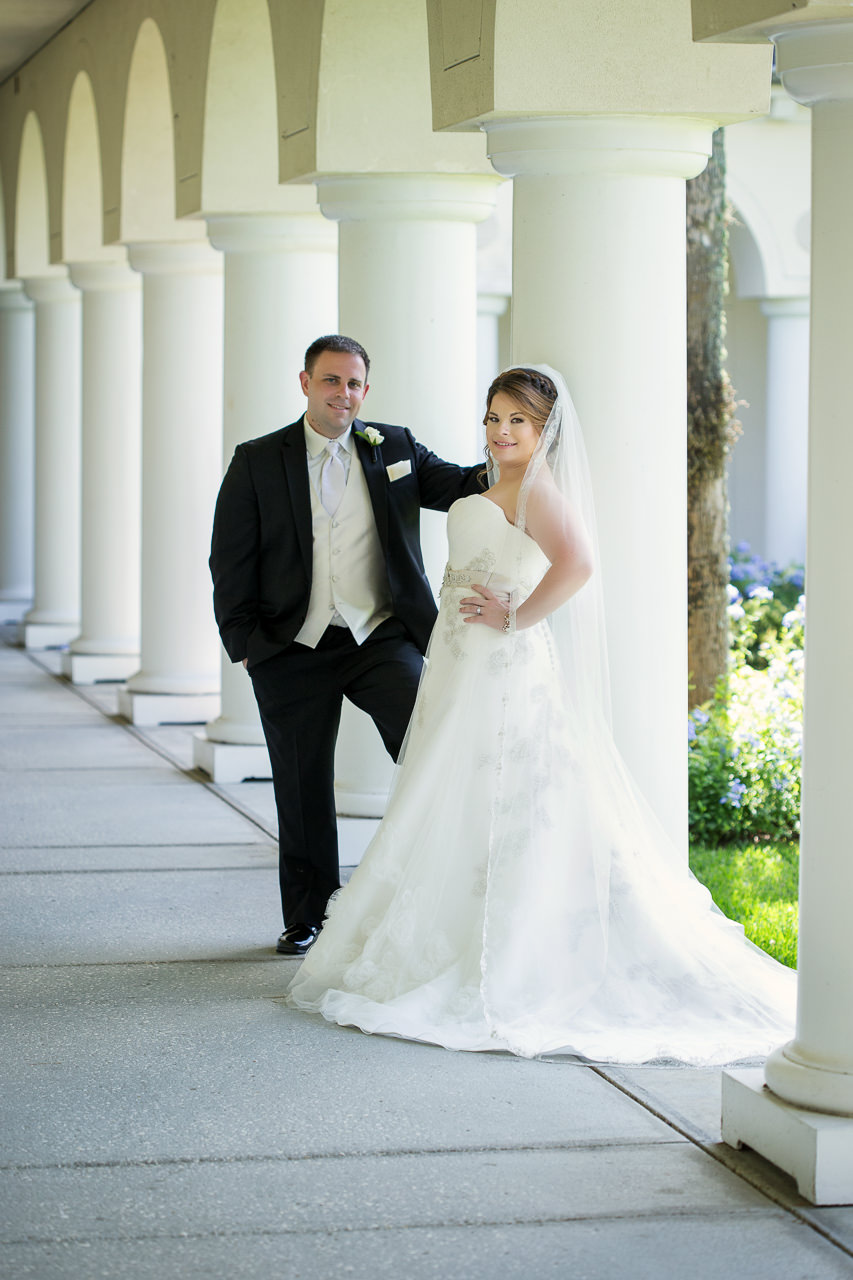 Tampa, Outdoor Bride and Groom Wedding Portrait in Ivory Wedding Dress and Veil and Black and White Groom's Suit | Tampa Wedding Photographer Jeff Mason Photography