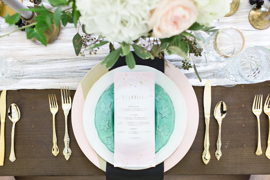 Ivory, White Rose and Blush Pink Wedding Centerpieces with Gold and Green Vintage China Charger and Gold Siliverware on Wooden Farm Table | Tampa Wedding Decor Ever After Vintage Rentals