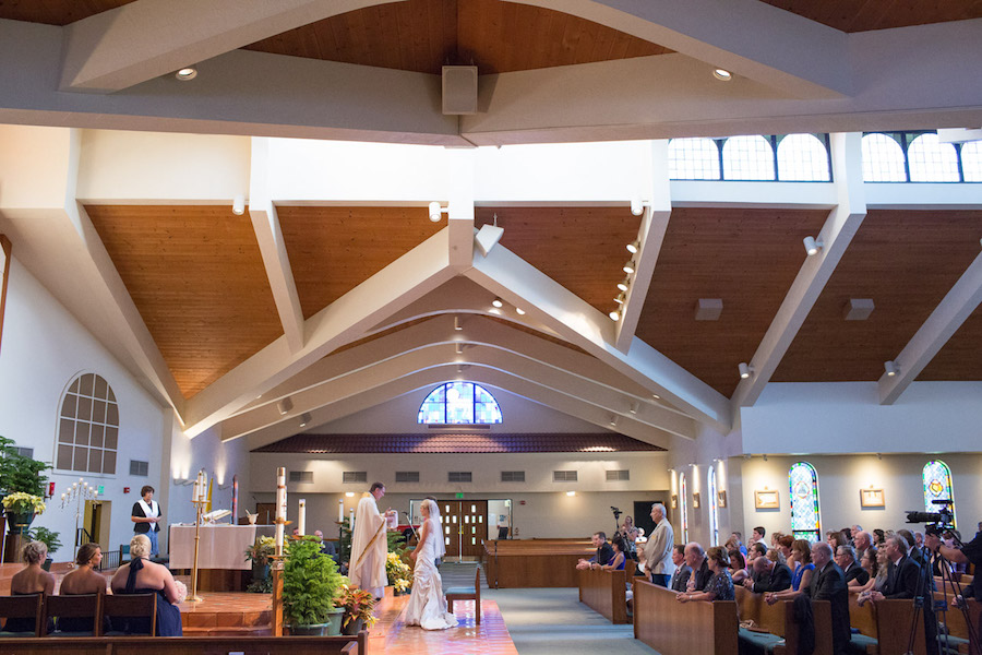 Bride in Allure Wedding Dress and Groom at Altar at Espiritu Santo Catholic Church Wedding Ceremony | St. Pete Wedding Photographer Jeff Mason Photography