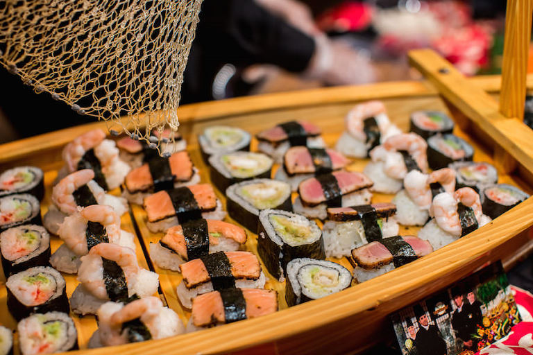 St. Petersburg Wedding Caterer Delectables Catering Sushi Rolling