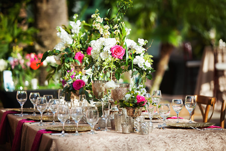 Garden Wedding Decor with White Centerpieces with Greenery in Gold Vases with Gold Textured Linens   St. Petersburg Wedding Florist Wonderland Floral Art and Over the Top Linen Rentals