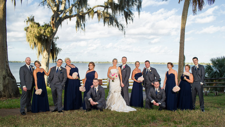 Outdoor, Waterfront Bridal Party Wedding Portrait with Navy Blue Bridesmaids Dresses and Grey Groomsmen Suits | St. Pete Wedding Photographer Jeff Mason Photography