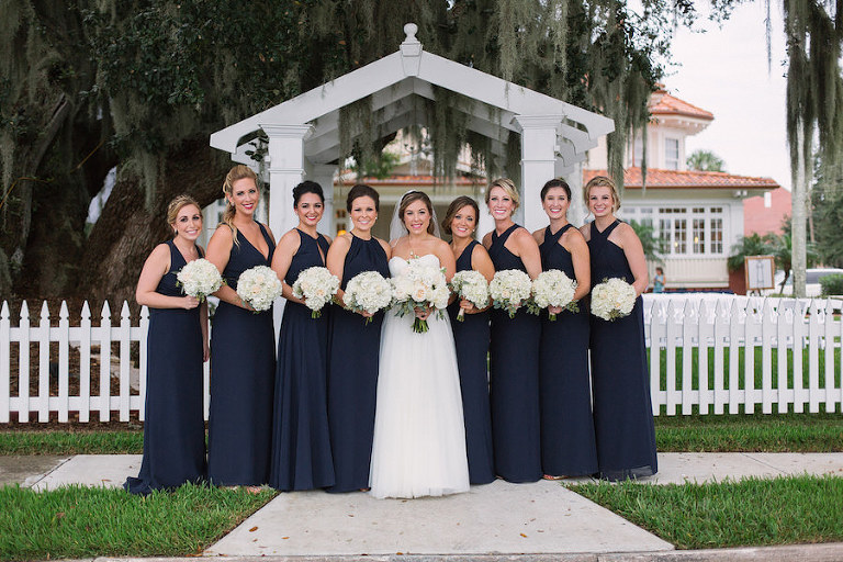 Outdoor, Florida Bride and Bridesmaid Wedding Portrait in Blue Bridesmaids Dresses and White Floral Bridal Bouquets | Tampa Bridesmaids Dress Shop Bella Bridesmaids