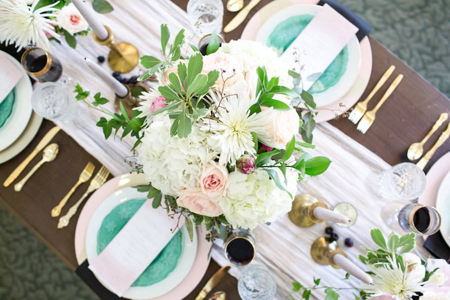 Ivory, White Rose and Blush Pink Wedding Centerpieces with Gold and Green Vintage China Charger and Gold Siliverware on Wooden Farm Table   Tampa Wedding Decor Ever After Vintage Rentals
